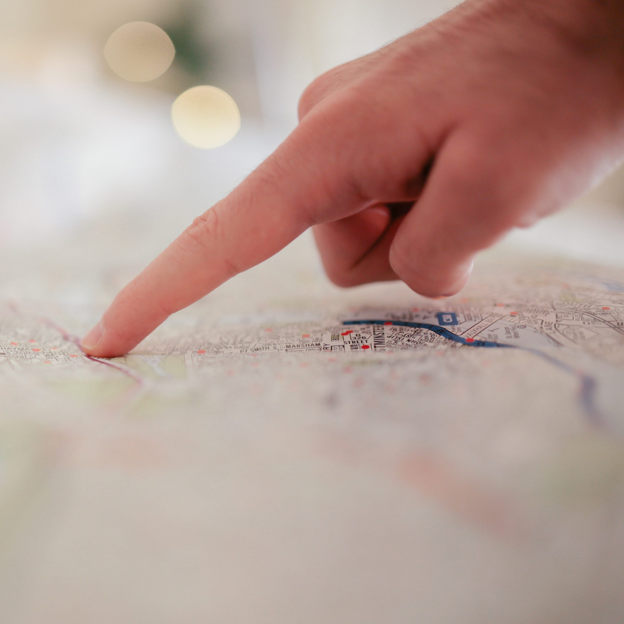 person-pointing-on-white-textile-34753-scaled
